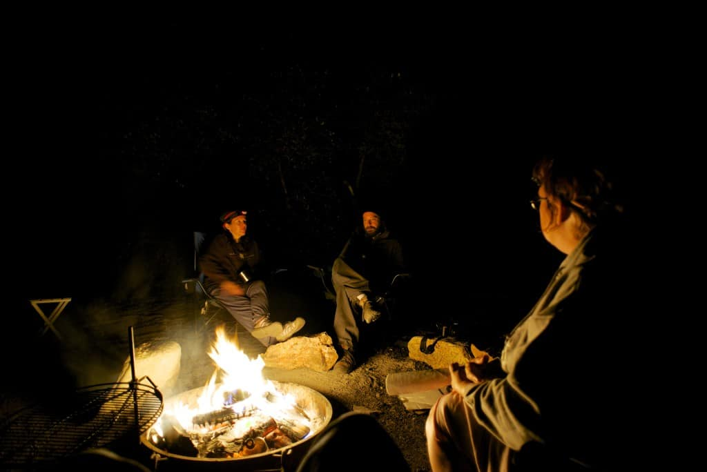 cooking on a campfire in the dark