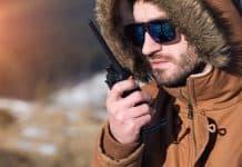 hiker using walkie talkie