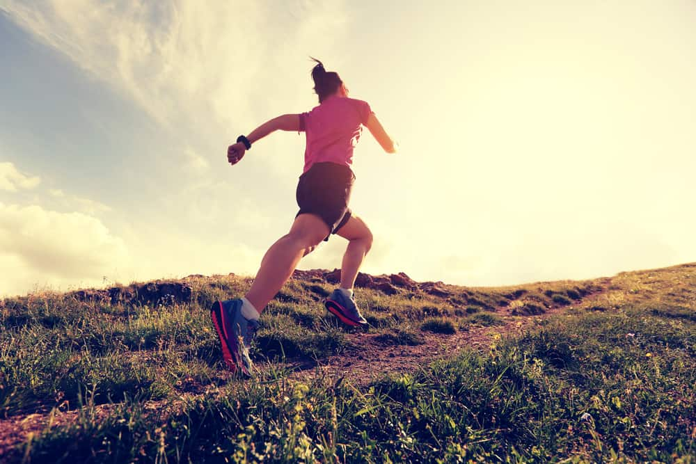 healthy young woman trail runner running