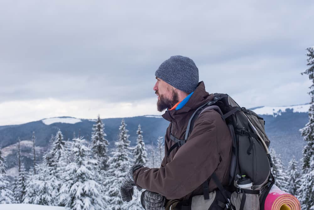 man dressed for cold weather hiking