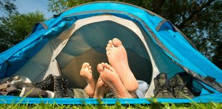couple in a tent with shoes off